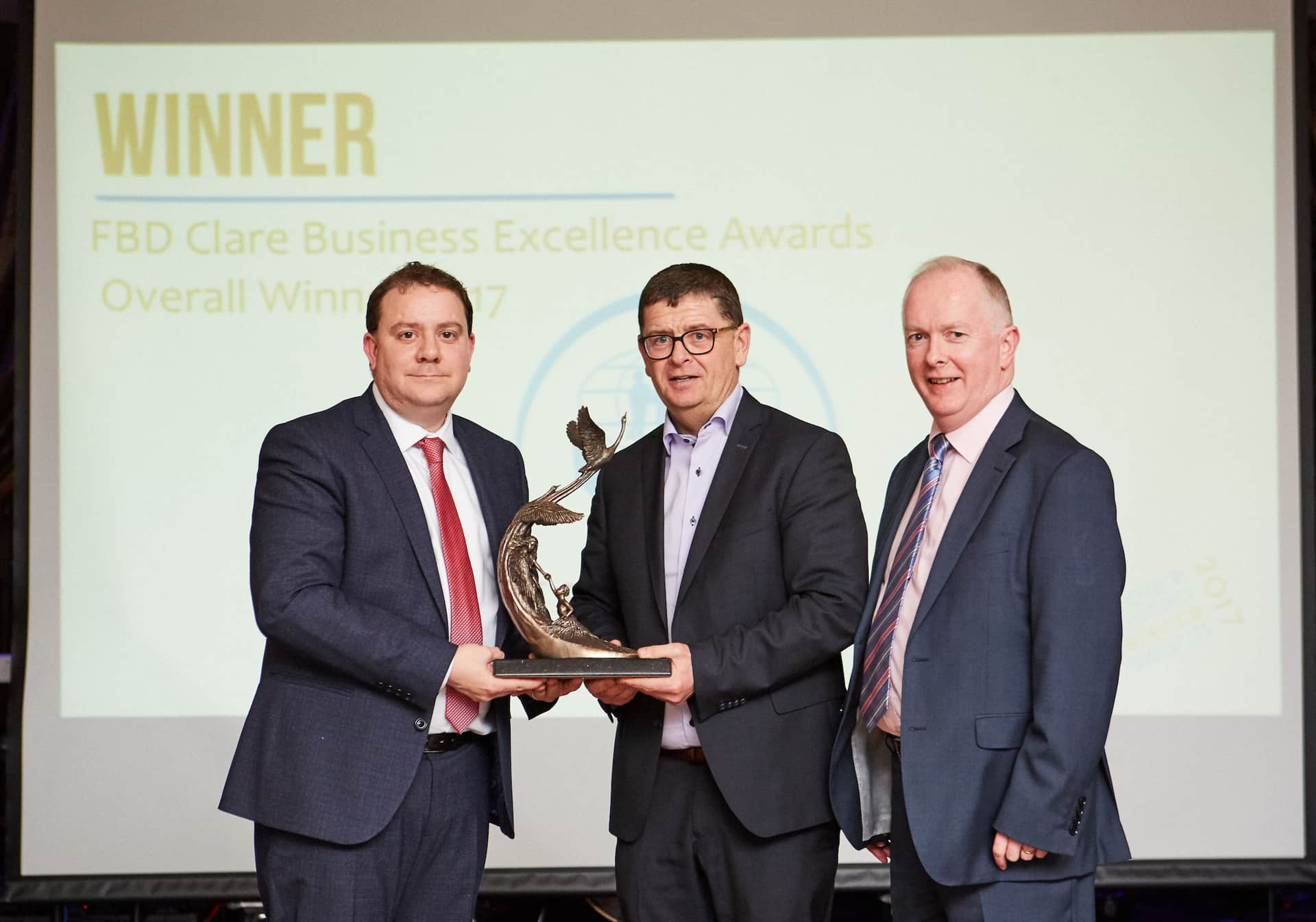 William Cahir President Ennis Chamber of Commerce, Louis Fay General Manager St Francis Credit Union (overall winner) and Mike Byrne MD of Acton BV. Photo: Mike Mulcaire