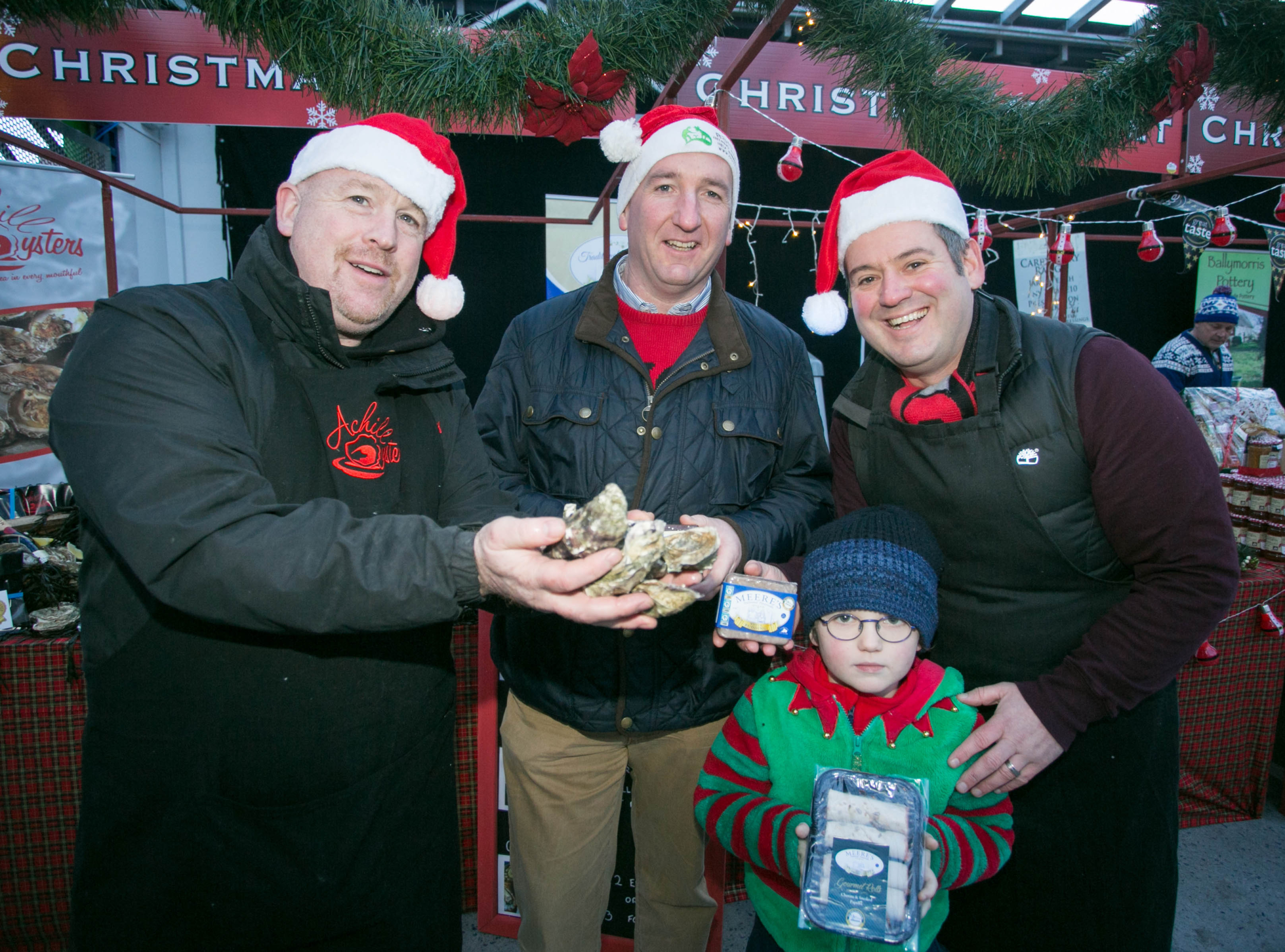 REPRO FREE 081217 Pictured at The Local Enterprise Office Christmas Fest Christmas market are Justin Kivlehan, Achill Oysters, Cllr Paul Murphy, mayor of Ennis, Barry Rees and Barach Rees (7) Meeres Pork Products .Pic Arthur Ellis.