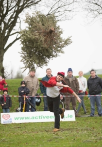 Martin Piotrowski taking part in the Christmas Tree Throwing Championships at Tim Smyth Park, Ennis on Sunday. Photograph by Eamon Ward