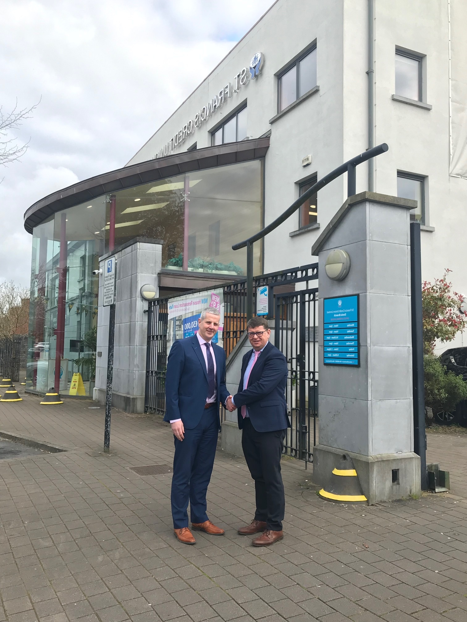 CEO Louis Fay welcoming Damien Browne to the St Francis Credit Union team in Ennis
