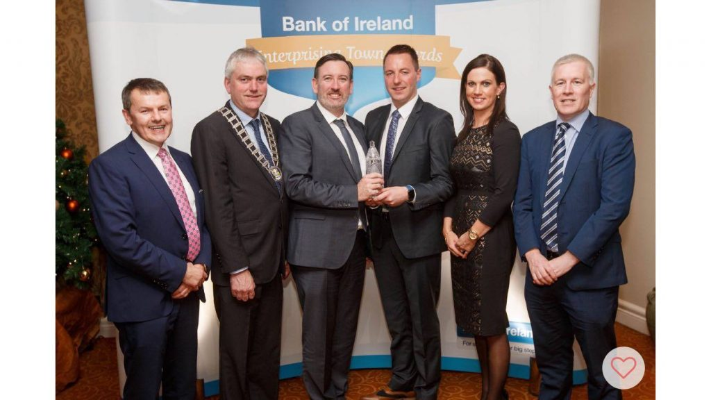 Pictured collecting the award is Padraic McElwee, Head of Local Enterprise Office Clare; Cllr Pat Burke, Leas-Cathaoirleach Clare Co Co; Cllr Ian Lynch; Charlie Glynn; Marie Meehan, Head of BOI Clare; and Noel Crowe, Manager BOI Kilrush.