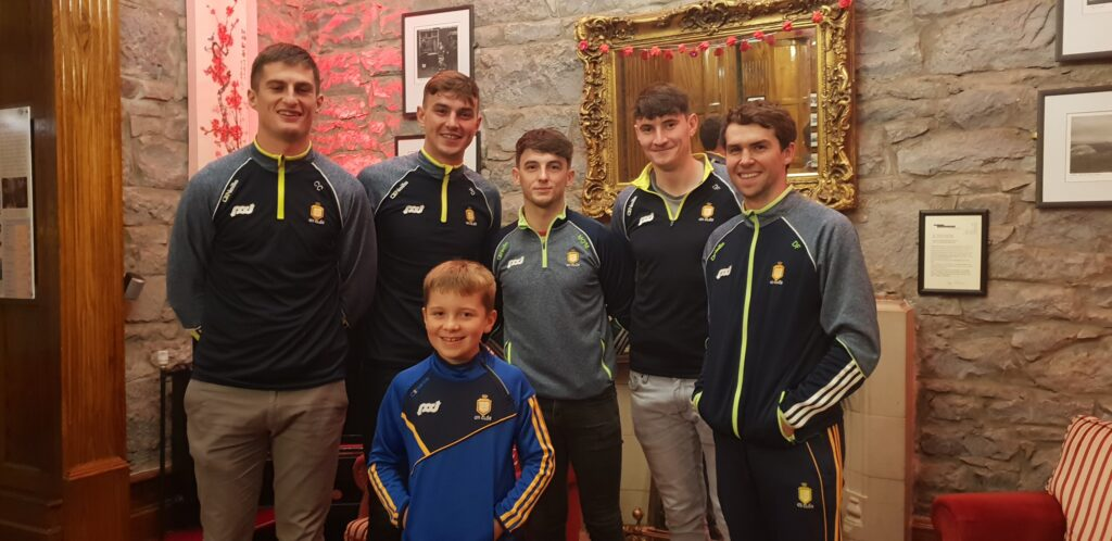 The Clare hurlers with young fan Pierce Shannon from Doolin